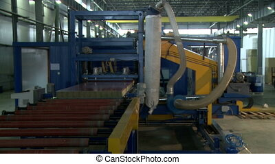View on fabricated SIP moves along conveyor - View on...