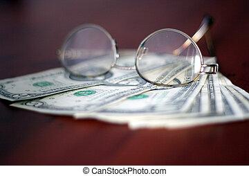 dollars - certain amount of the small dollars on dark...