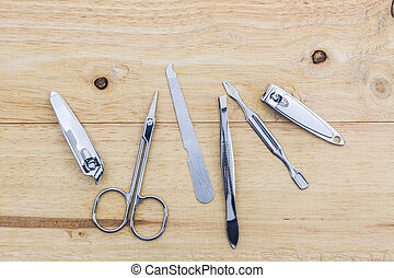 Tools of a manicure set. - Tools of a manicure set on wood...