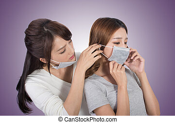 woman with her friends with mask - Sick woman with her...