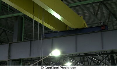 View on working overhead crane, close-up