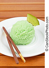 Kiwi ice cream - Delicious kiwi ice cream ball on white dish...
