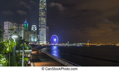 Skycrapers night timelapse and Hong Kong Observation Wheel,...