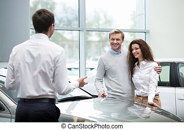 Dealership - Young couple buying cars