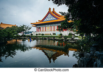 The National Concert Hall and pond at Taiwan Democracy Memorial Park, in Taipei, Taiwan.
