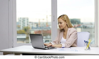 smiling businesswoman with laptop and papers - business,...