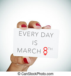 text every day is march 8th in a signboard - the hand of a...