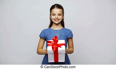 happy smiling girl holding gift box - childhood, people,...
