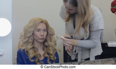 Make-up artist doing make-up model - Make-up artist doing...