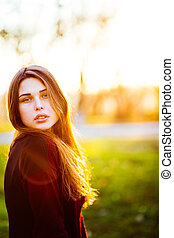 Portrait of beautiful young brunette girl in the Park