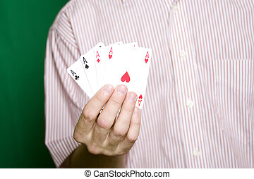 Winning Hand - A young man in a red striped shirt, holding...