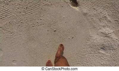 male feet walking along sandy beach - travel, tourism,...