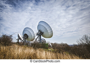 huge sattelite transmitter - large sattelite dish in the...