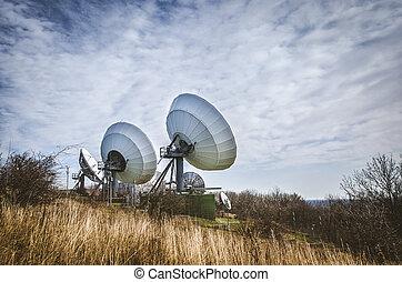 huge sattelite transmitter - large sattelite dish in the...