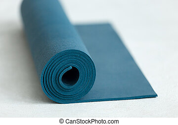 Rolled up fitness mat - Rolled up blue yoga, pilates or...