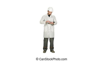 Technician building site using tablet to check progress on white background.