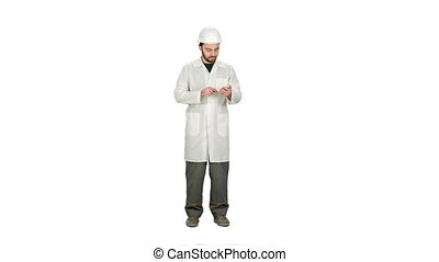 Healthcare professional, doctor, nurse, dentist, researcher, physician assistant, reading text sms, message on cell phone on white background.