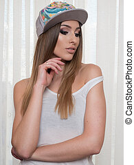 beautyfull woman wearing hat and vest on white