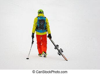 Sad and weary skier goes away, dragging skis - Sad and weary...