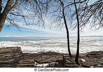 Winter Lake Erie - The icy, cold and rocky shore of Lake...