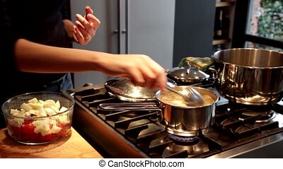 preparation of broth, fresh vegetables, fennel and tomatoes