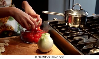 cut fennel and cherry tomatoes - preparing fresh vegetables,...