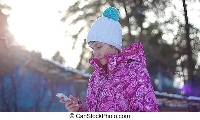 Girl send sms in winter forest HD
