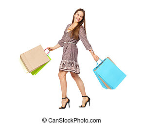 Fullbody portrait of beautiful woman with bags isolated on...