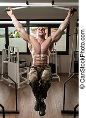 Young Man Doing Exercise For Back - Young Male Bodybuilder...