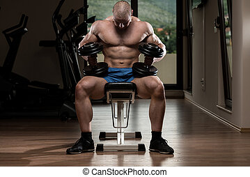 Young Man Preparing Himself For Work Out - Young Man With...