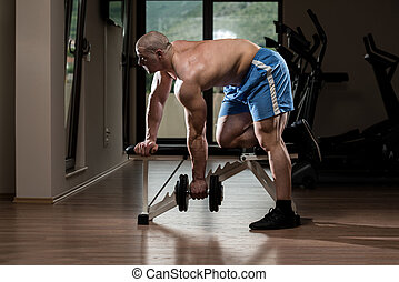 Young Bodybuilder Exercise Back In The Gym - Muscular Man...