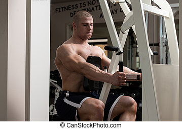 Young Man Doing Back Exercises In The Gym - Male Bodybuilder...