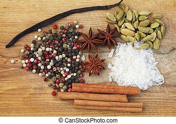 Various seasonings on wooden background - Spices. Various...
