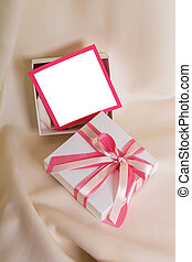 White gift with a pink bow