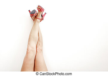 Sexy legs and high heels isolated on white