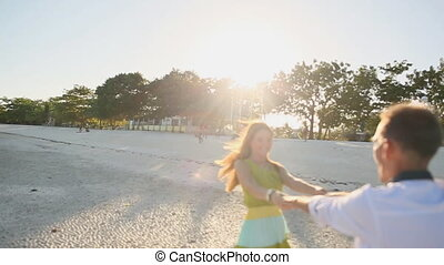 Love Couple Circling The Sun - Girl And Guy Circling The Sun...