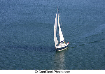 Single yacht on blue sea