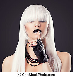 beautiful blonde woman with black make-up and accessories...