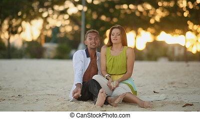 Love Couple Throw Sand On A Beach