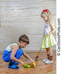 Little Boy and Girl Cleaning at Home Together