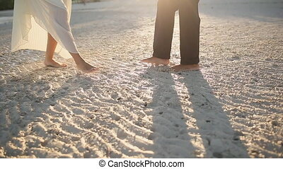 Love Couple Walk On A Wet Evening Beach