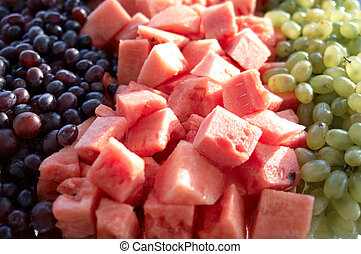 Fruits - A lot of watermelon cubic pieces and grapes