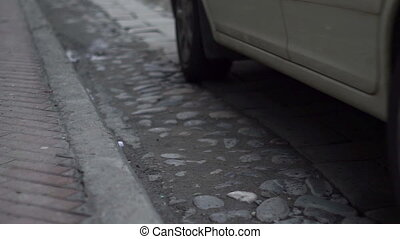 Cobblestone and Flagstone Road Cars - Static low angle shot...