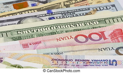 Yuan vs Dollar bank notes rotating concept business...