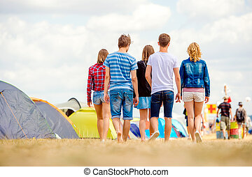Unrecognizable teenagers, tent music festival, sunny summer,...