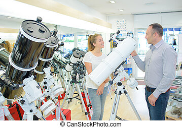 Two people in telescope store