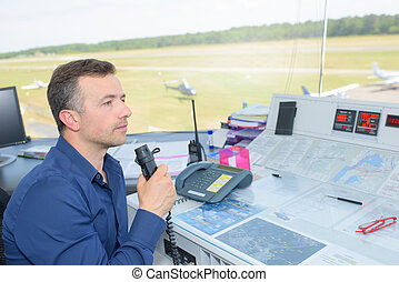 man in the air control tower
