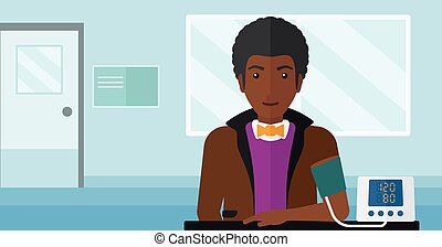 Blood pressure measurement - An african-american man with...