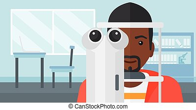 Patient visiting ophthalmologist - An african-american man...