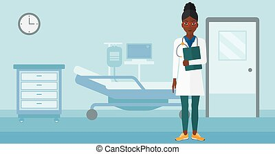 Doctor in hospital ward - An african-american doctor with...